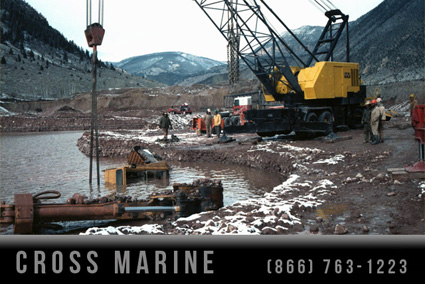 Divers Salvage Excavator From Tailings Pond